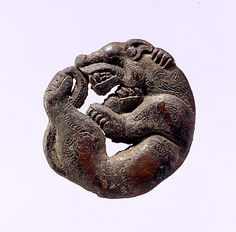Strap crossing in the Shape of a coiled wolf: 5th century BC, Eastern Eurasia