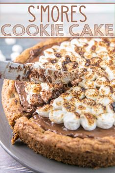 S'mores Cookie Cake: a giant graham cracker chocolate chip cookie cake, covered with a layer of melted milk chocolate and toasted s'mores. A perfect nostalgic childhood treat! Bunsen Burner Bakery via Best Dessert Recipes, Easy Desserts, Cookie Recipes, Delicious Desserts, Recipes Dinner, Pasta Recipes, Crockpot Recipes, Soup Recipes, Vegetarian Recipes
