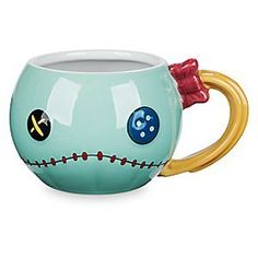 Scrump Sculptured Mug - Lilo & Stitch | Disney Store If quirky is your cup of tea (or coffee), you'll flip over Scrump! Bedecked with buttons and bow, this fun, freaky, fully sculptured mug was inspired by Lilo's handmade doll in Disney's <i>Lilo & Stitch</i>.