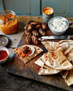 Make this lamb kofta recipe with accompanying sauces ahead of time for a dinner party feast.