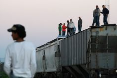 US border crossing of illegal immigrants trains | stand on top of train cars while waiting for the freight train ...