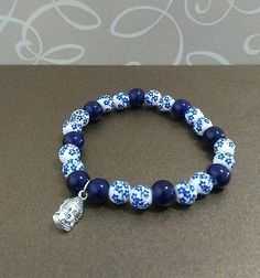 Blue and white Glass beads stretch bracelet. Buddha
