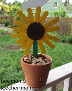 Popsicle stick sunflowers. → Materials: craft sticks, glue, cardboard cereal box, scissors, pencil, and paint.