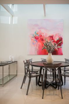 Jewels Stevens Artwork and Kartell Chairs Styling The Real Estate Stylist