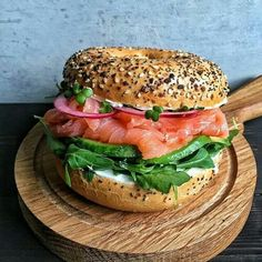 Salmon avocado sandwich on a toasted Everything Bagel