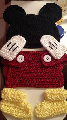 I'm not into Disney, but this came out really cute. Wish the colors showed up as they're supposed to.  I used the diaper part of this pattern, and the gloves, but the hat and booties we...