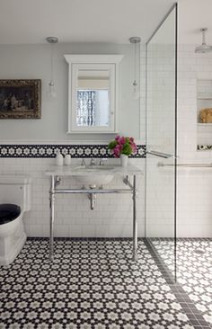 Flower patterned black and white tile floor with industrial-inspired sink designed by @Liz Caan Interiors LLC