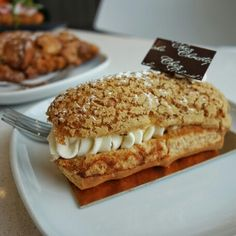 Lovely. Eclair Coconut & Passion Fruit - Coconut cream and passion fruit curd in choux pastry with decadent white chocolate at @chezchristophe in #Burnaby @BurnabyHeights #BurnabyBC #BurnabyHeights #pastry #pastries #Dessert #Desserts #FMFChezChristophe