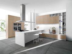 cuisine bois et blanc moderne avec un carrelage de sol imitation béton et accents en acier inox