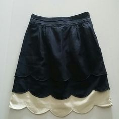 """Anthropologie Floreat Scalloped Cloud Skirt Sz 6 Floreat by Anthropologie Scalloped Cloud Skirt. Size 6. Dark Blue and Cream. Exposed Side Seam Zipper. Triple Layers with Scalloped Hems. Fully Lined. Cotton/Silk Blend. Pre-owned with no stains, holes or other issues noted.  Measurements: 30"""" waist (doubled) 40"""" hip (doubled) 20"""" skirt length Anthropologie Skirts A-Line or Full"""