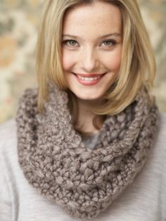 Free Pattern - With a stylish twirling pattern, this cozy #knit cowl is an excellent layering piece for topping off your fall and winter looks.