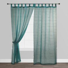 Our lightweight Blue Jute Striped Sahaj CurtainBlue Striped Sahaj Jute Curtains are perfect for any room in your home. Natural jute fiber is woven horizontally into this lightweight cotton curtain, giving it texture and visual interest - plus, the soft blue shade complements a variety of decors.