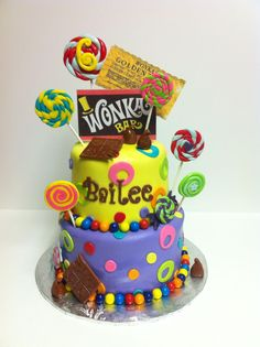 Willy Wonka inspired birthday cake. Gumball border with fondant chocolate bars and lollipops.