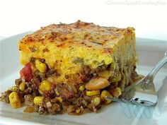 """This is a hearty recipe for Chili Pie with a Green Chile & Cheddar Cornbread Crust. You may know it as Tamale Pie....  This is a Tex-Mex favorite with a chili 'filling' that gets smothered in cheese then topped with cornbread batter 'crust' and baked in the oven for a cheesy, spicy finish."""