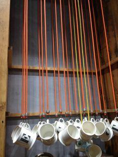 Bungee cord coffee mug display