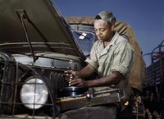Colored mechanic, motor maintenance section, Ft. Knox, Kentucky. Photographed in June, 1942.