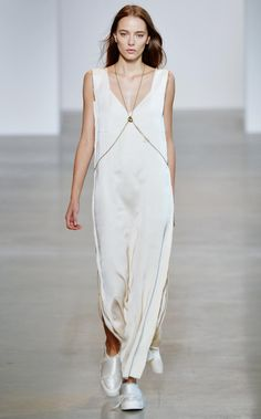 The slinky, silky frocks at Calvin Klein Collection's SS16 were similar to his Nineties collection of waifish dresses formerly modelled by Kate Moss. This time though designer Francisco Costa added chain detailing and asymmetrical cold-shoulder straps.