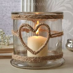 1001 Ideas for Summer DIYs to Brighten Up Your Home summer crafts big jar decorated with burlap ropes with heart-shape detail containing one lit candle The post 1001 Ideas for Summer DIYs to Brighten Up Your Home appeared first on Summer Diy. Pot Mason Diy, Mason Jar Crafts, Bottle Crafts, Mason Jars, Diy Candles, Candle Jars, Homemade Candles, Candle Decorations, Mason Jar Candle Holders