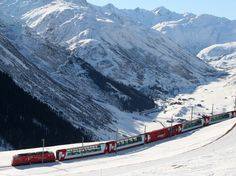 Glacier Express-an express train connecting railway stations of the two major mountain resorts of St. Moritz and Zermatt in the Swiss Alps #travel #vacation #trainn