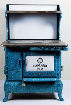 """The """"Oakland Duo"""" gas oven and stovetop in speckled blue, black and white enamel. Antique Kitchen Stoves, Antique Wood Stove, How To Antique Wood, Old Wood, Vintage Kitchen, Cool Kitchen Appliances, Vintage Appliances, Cool Kitchens, Wood Burning Cook Stove"""