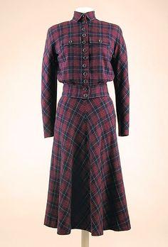 Hattie Carnegie Wool Plaid Suit  American, 1947  Of navy, red and blue soft plaid. Eisenhower jacket top.