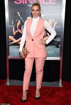 Flamingo pink: Busy Philipps looked comfy in her pink vest and trouser set with white turt...