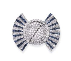 A SAPPHIRE AND DIAMOND BROOCH   Designed as a stylised bow, the central pavé-set and marquise-cut diamond disc flanked by calibré-cut sapphire and diamond fans, mounted in platinum, circa 1935, 6.4 cm wide