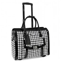 """Cabrelli Victoria Houndstooth Laptop Rollerbriefairplane carry-on size executive Rollerbrief, a houndstooth printed beauty with black patent trim detailing, is fitted for the working, traveling woman who appreciates the smart and unconventional, offering space, structure and style. It features two padded compartments for a 15"""" laptop as well as an electronic tablet, a concealable retractable handle, roller-blade wheels, and much more."""