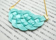 Knotted rattail necklace in mint and gold - nautical - pastel turquoise - summer trends. $27,00, via Etsy.
