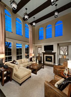 Toll Brothers Soaring two-story family room for relaxing in style. Love the one windowed wall in this 2 story living room! New House Plans, Modern House Plans, Bella Furniture, Furniture Ideas, Family Room Design, Family Rooms, Room Wall Decor, New Homes For Sale, My Dream Home