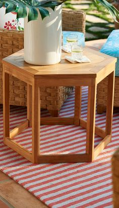 The hexagonal shape of our Sanibel Side Tables balance the woven wicker design of the coordinating seating. Crafted from solid teak, these tables will acquire a rich patina over time.  | Frontgate: Live Beautifully Outdoors