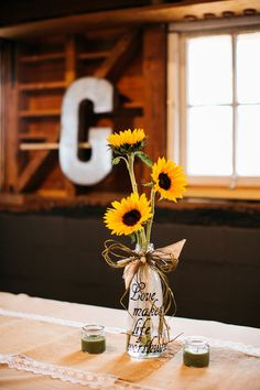 Simple sunflower bouquet at Hadley and Kodi's Vintage Rustic Georgia Wedding at Fritz Farm. TR Photography