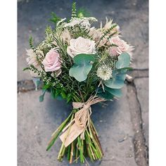 We love the added touches to this wedding bouquet. The brown string and name tag are a super cute way to personalise your wedding day and the large amount of green in the bouquet keep it looking fresh and beautiful. Pastel colours are perfect for rustic bouquets and this is a perfect example of how gorgeous they can look.