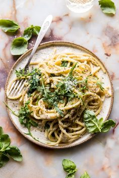 Cacio e Pepe with Arugula and Lemon: Made from pantry staple ingredients, takes 15-20 mins to make, and is really delicious. Meaning it's perfect for those nights when there's nothing in your fridge, or all you feel like doing is eating pasta + binge watching Netflix, or a surprise guest shows! @halfbakedharvest.com