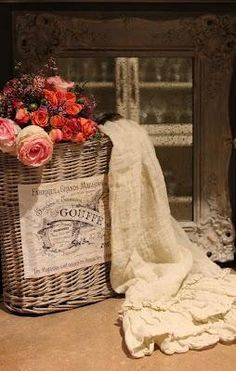 Draping an old piece of luxurious lace or a doilie over the corner of an old basket, with lovely silk or real roses (must LOOK real) and perhaps some pearls or a pocket watch sitting on top...get creative.!!!