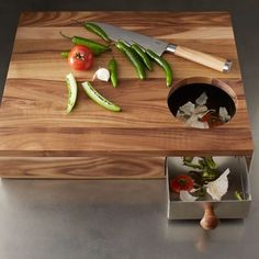West Elm - Storage Cutting Board. I love the idea of being able to scrape my trash into the tray for removal later, rather than going back and forth to the trash can.