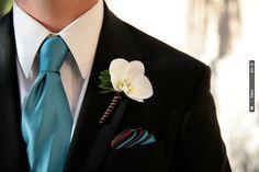 Turquoise necktie and orchid boutonniere. | VIA #WEDDINGPINS.NET