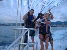 Parasailing in Hawaii-John we will have to find one that can take up three people.  Renee can watch our stuff.  LOL