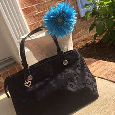 """Beautiful black Brighton Mevelyn tote/handbag Rich black shimmery microfiber tote embossed with a floral design, leather trim. Never used. It has a reinforced bottom which makes it self-standing. Height 10.5"""", width 15.5"""", depth 5"""" Brighton Bags Totes"""