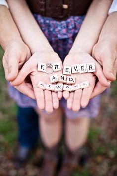 Cute wedding photo idea.it can hold it or drop it,,lol hands can...