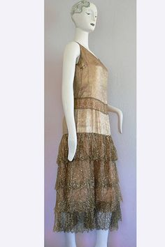 Beautiful dress although I think my hips might be too big for it =0(  1920s Gold Lame' and Gold Lace Dress