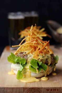 FRENCHIE BURGER ~~~ a drool-worthy creation of a beef burger topped with bearnaise sauce, pommes frites, and watercress