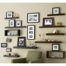 Love this wall arrangement..I like the black and brown together