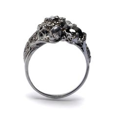 Julia deVille. Ring: Deco Ring with Skulls, 2012. White Gold, Black and White Diamonds.