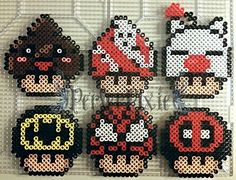 Mushrooms perler beads ( Happy Poo, Ghostbusters, Moogle, Batman, Spiderman and Deadpool) by PerlerPixie