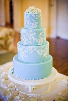 Four-Tier Blue Wedding Cake with Piped Lace Pattern | Brides.com