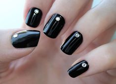 "We call this ""Midnight Ball Drop"" because it's reminiscent of a glam New Year's Eve night with the ball dropping in Times Square. Black nail polish is a staple color you should always have in your polish kit. Stylish yet serious, it's the perfect base color to have in your repertoire year-round for parties, date nights, and upscale events."