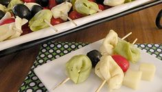 Tortellini Skewers~Impress guests with this quick and easy Italian appetizer recipe submitted by Sam's Club members and mother-daughter bloggers at caramelpotatoes.com. Olive Garden® Salad Dressing and frozen tortellini help you cut the prep, but keep great taste.