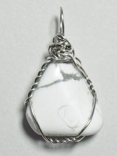 Calming, white and gray, genuine polished Howlite stone pendant, unique and artistically handmade - wired in .925 sterling silver round wire.