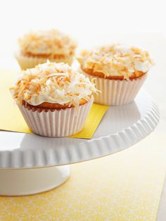 Lemon-Filled Coconut Cupcakes : Sandra spruces up yellow cake mix with coconut milk and lemon pudding mix for an easy-to-assemble, flavorful cupcake.